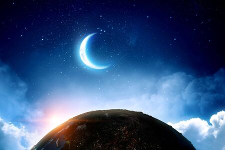 Earth, moon and stars on blue sky