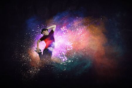 Modern dancer jumping with colourful splashes background. Mixed media Stock Photo