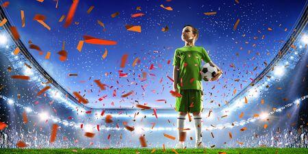 Little soccer champion. Mixed media Фото со стока