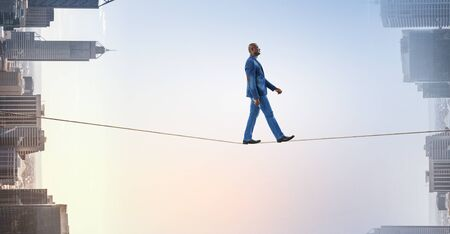 Joyful black man wearing casual clothes walk. Mixed media Фото со стока