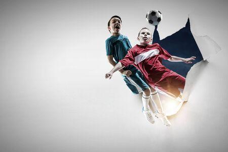 Little soccer champions. Mixed media Фото со стока