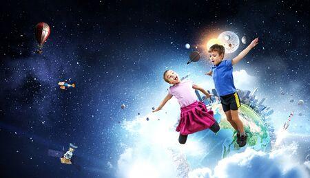 Cute happy little children jumping. Mixed media