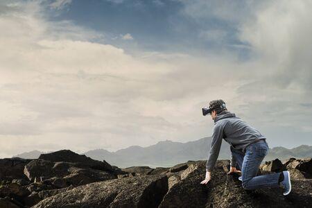 Young man in virtual reality. Mixed media