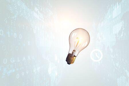 Light bulb on digital screen background