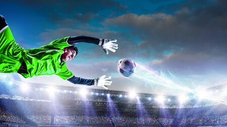 Soccer players on stadium in action. Mixed media Stock Photo
