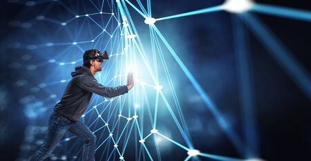 Virtual reality experience. Man in VR glasses Stock Photo