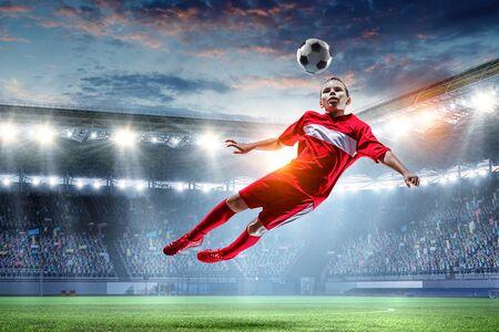 Little soccer champion. Mixed media 版權商用圖片