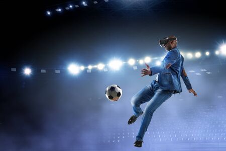 Virtual Reality headset on a black male playing soccer. Mixed media