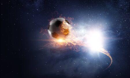 Soccer ball on fire and dark starry sky Stock fotó