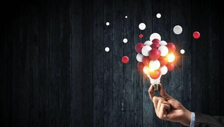 Pixelated light bulb. Development concept. Mixed media