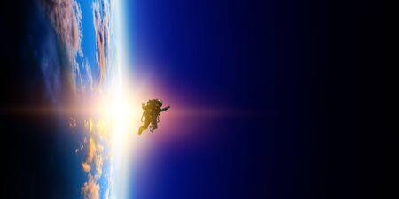 Astronaut at spacewalk on planet orbit. Archivio Fotografico - 126215557