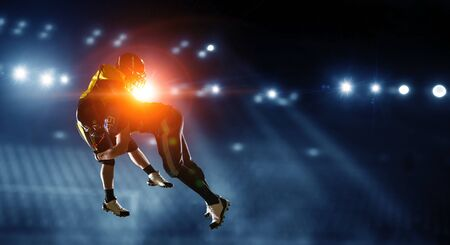 American football players in motion. Mixed media