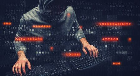 Hacker with his hands on two keypads, with digital code in the foreground Standard-Bild - 126216589