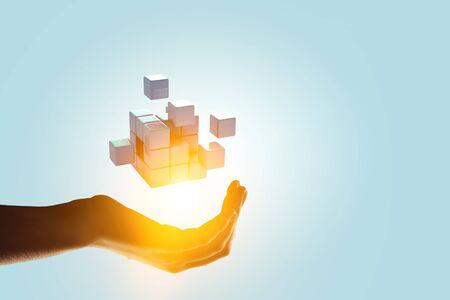 Man`s hand and cubes levitating above. Mixed media 免版税图像