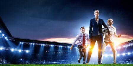 Business team on football stadium. Mixed media