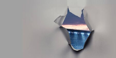 Paper torn hole effect with stadium view