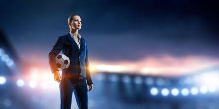 Business lady on football stadium. Mixed media