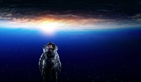 Spaceman and planet, human in space concept