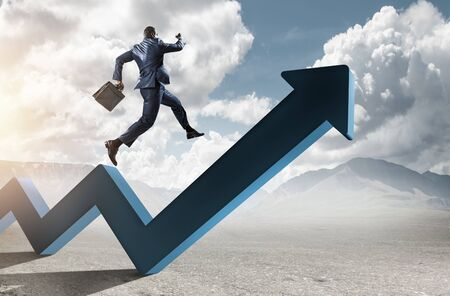 Black businessman running on blue zigzag increasing arrow