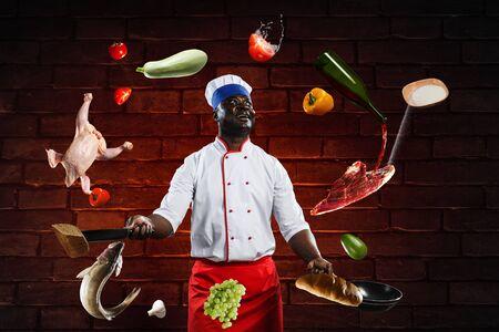 Black chef creative cooking. Mixed media. Stock Photo