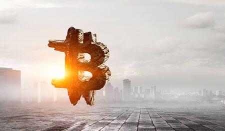 Bitcoin symbol on cityscape background