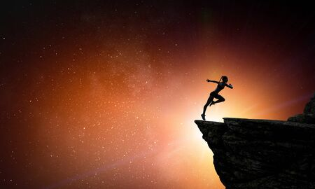 Jumping over precipice, challenge concept. Archivio Fotografico