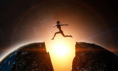 Jumping over precipice, challenge concept. Foto de archivo - 127833003