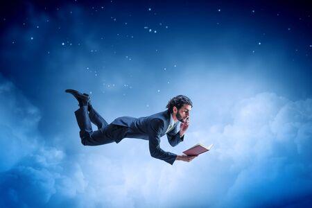 Joyful happe businessman levitating horizontally