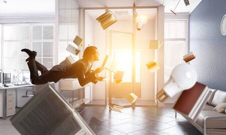 Joyful happe businessman levitating horizontally Zdjęcie Seryjne