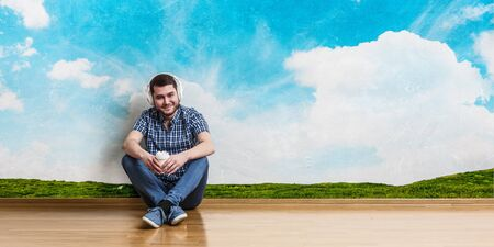 Young man sitting on floor, a moment for relax concept