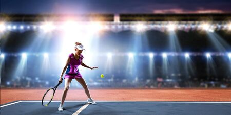 Young woman playing tennis in action