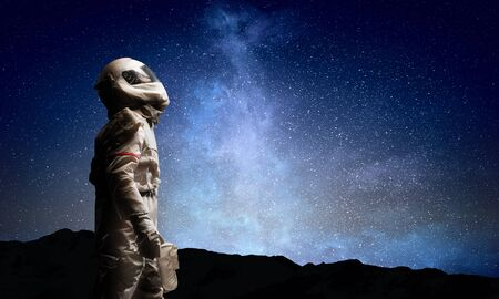 Spaceman and the planet Earth abstract theme Imagens