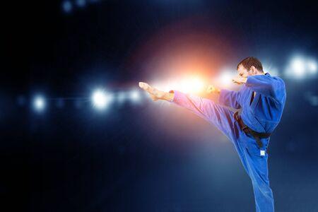 Professional karate kick by young man 版權商用圖片