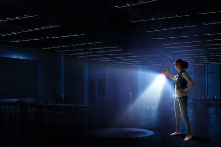 Young woman holding a flashlight Banco de Imagens