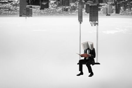Businessman with notebook head. Business efficiency concept. 写真素材