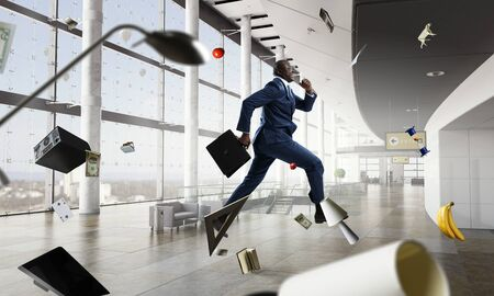 Running black businessman with briefcase