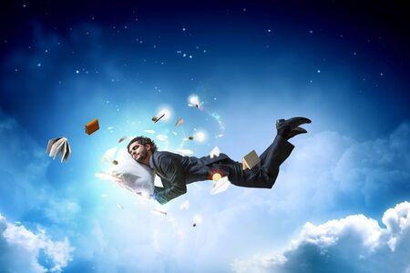 Joyful happe businessman levitating horizontally 写真素材