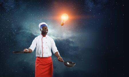 Black chef creative cooking. Mixed media. 写真素材