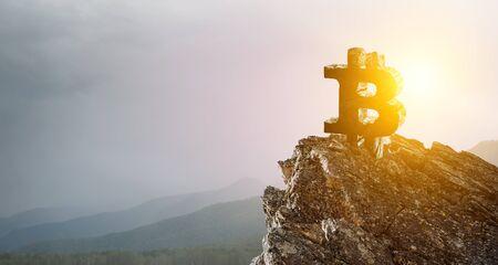 Bitcoin symbol on mountain peak