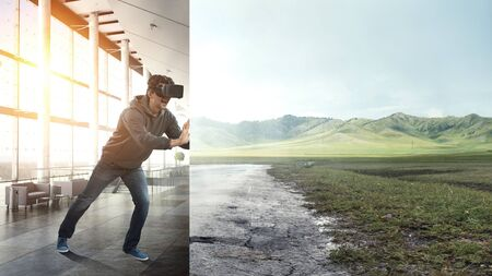 Virtual reality experience. Man in VR glasses 스톡 콘텐츠