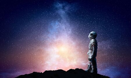 Spaceman and the planet Earth abstract theme 写真素材