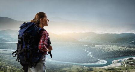 Travelling female tourist with backpack 스톡 콘텐츠