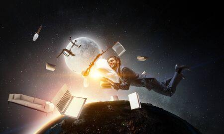 Joyful happe businessman levitating horizontally 스톡 콘텐츠
