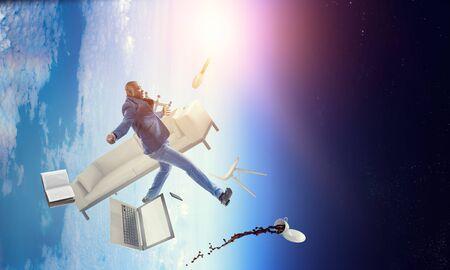 Businessman jumping in gravity. Mixed media Banco de Imagens