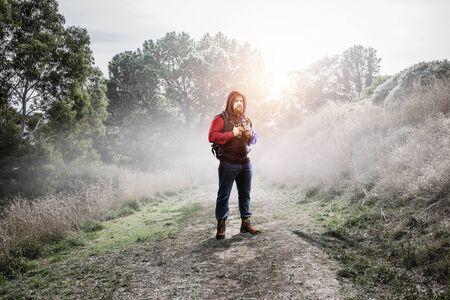 Hiker man with sticks. Mixed media