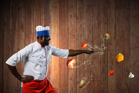 Black chef creative cooking. Mixed media. 写真素材
