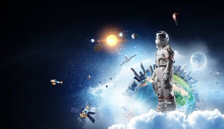 Spaceman and the planet Earth abstract theme Stock fotó - 128813565