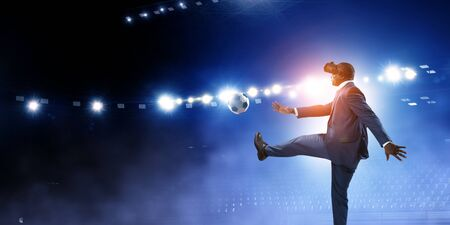 Black businessman on virtual reality football match