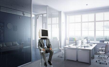 Monitor headed businessman. Mixed media 스톡 콘텐츠