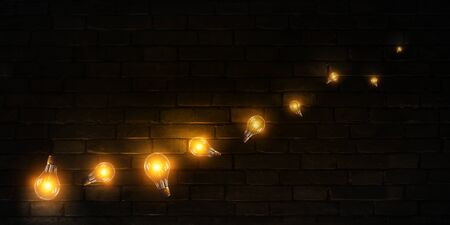 Burning lights on a dark background of a brick wall Banque d'images - 128994350